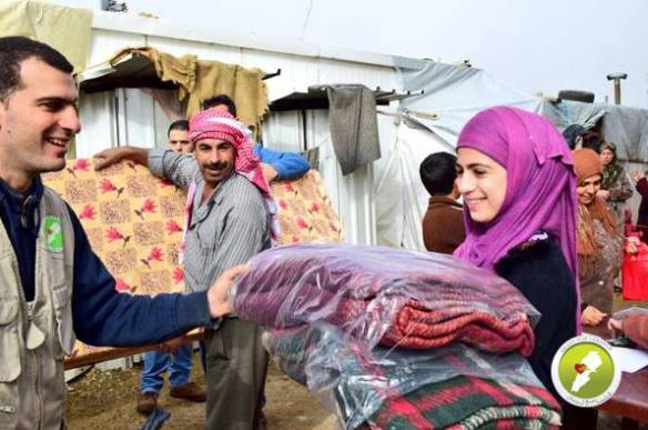 Distributing blankets to refugees